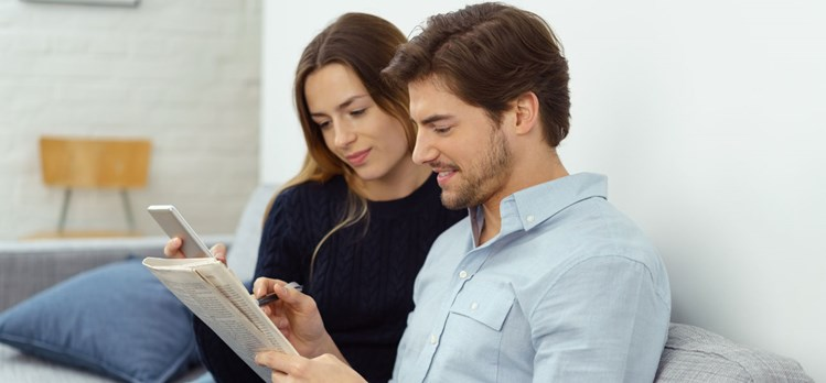 Young couple searching for listings